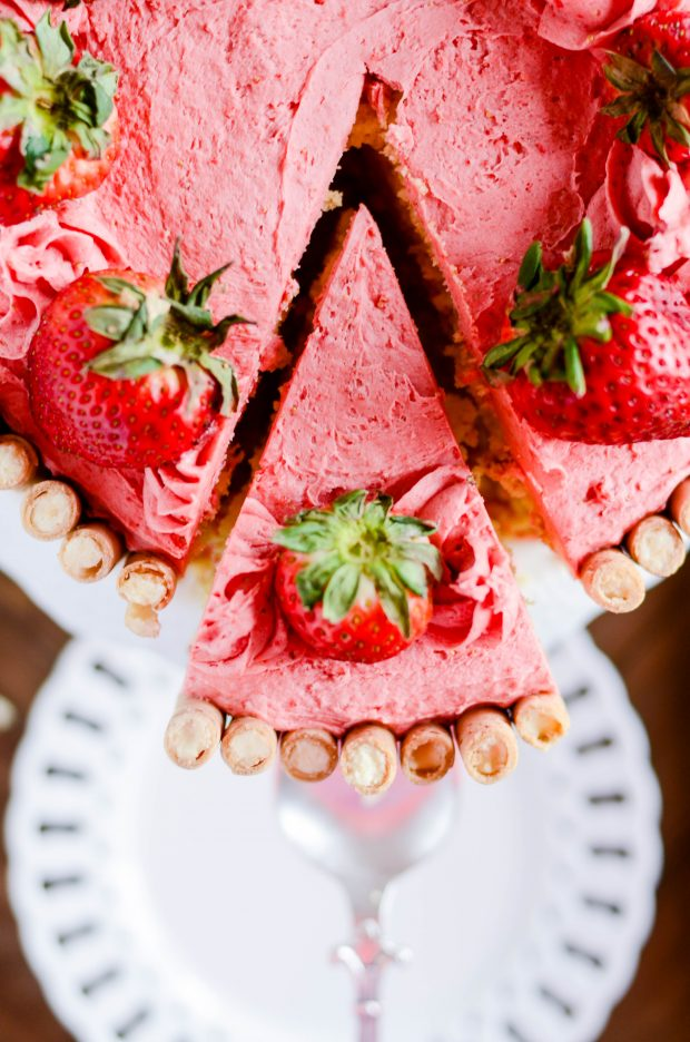 Light and fluffy lemon cake with a dreamy homemade strawberry buttercream. The perfect spring dessert!