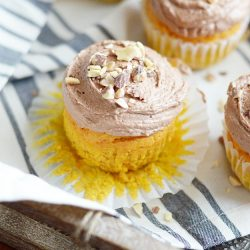 Soft and moist, spiced pumpkin cupcakes perfectly paired with whipped Nutella buttercream.