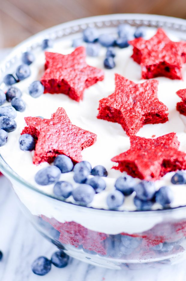 Layers of sweet red velvet cake, cheesecake filling, and juicy blueberries make an easy and patriotic summertime trifle.
