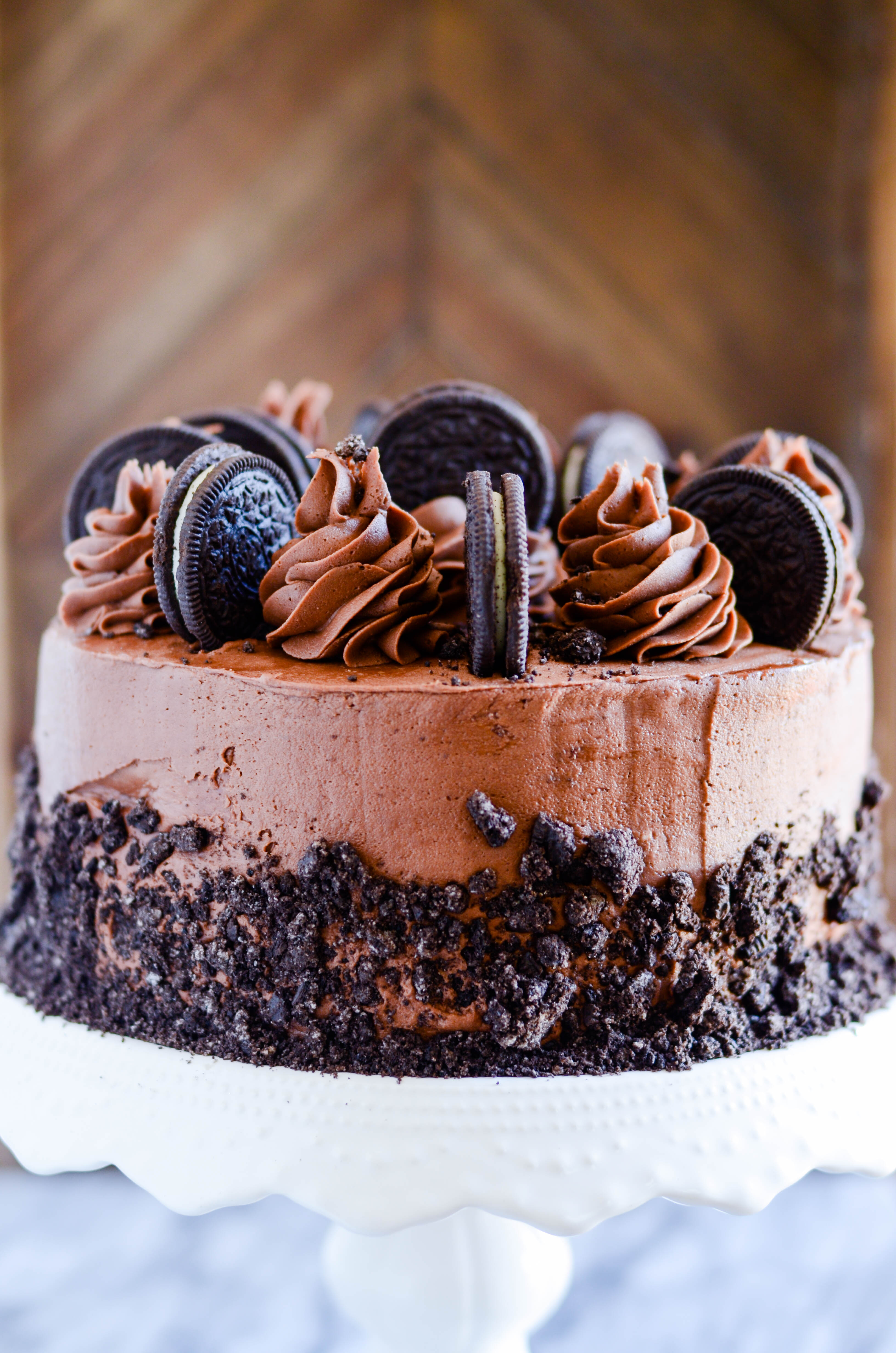Two layers of rich, chocolate Oreo cake with a fudgy chocolate buttercream and Oreo crumbles on top.