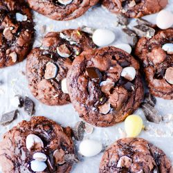A recipe for super fudgy, brownie-like cookies filled with chocolate chunks and chocolate Easter eggs.