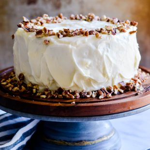 This Pumpkin Cheesecake Cake has two flavorful layers of pumpkin cake with a simple 3-ingredient cheesecake in the middle