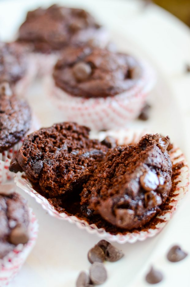 Indulgent chocolate muffins with a secret ingredient that makes them extra soft, extra fudgy, and extra chocolate-y!