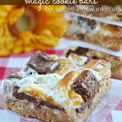 Nutter Butter S'mores Magic Bars on www.somethingswanky.com #recipes #dessert