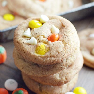Soft and chewy snickerdoodle cookies with white chocolate M&Ms and white chocolate chips.