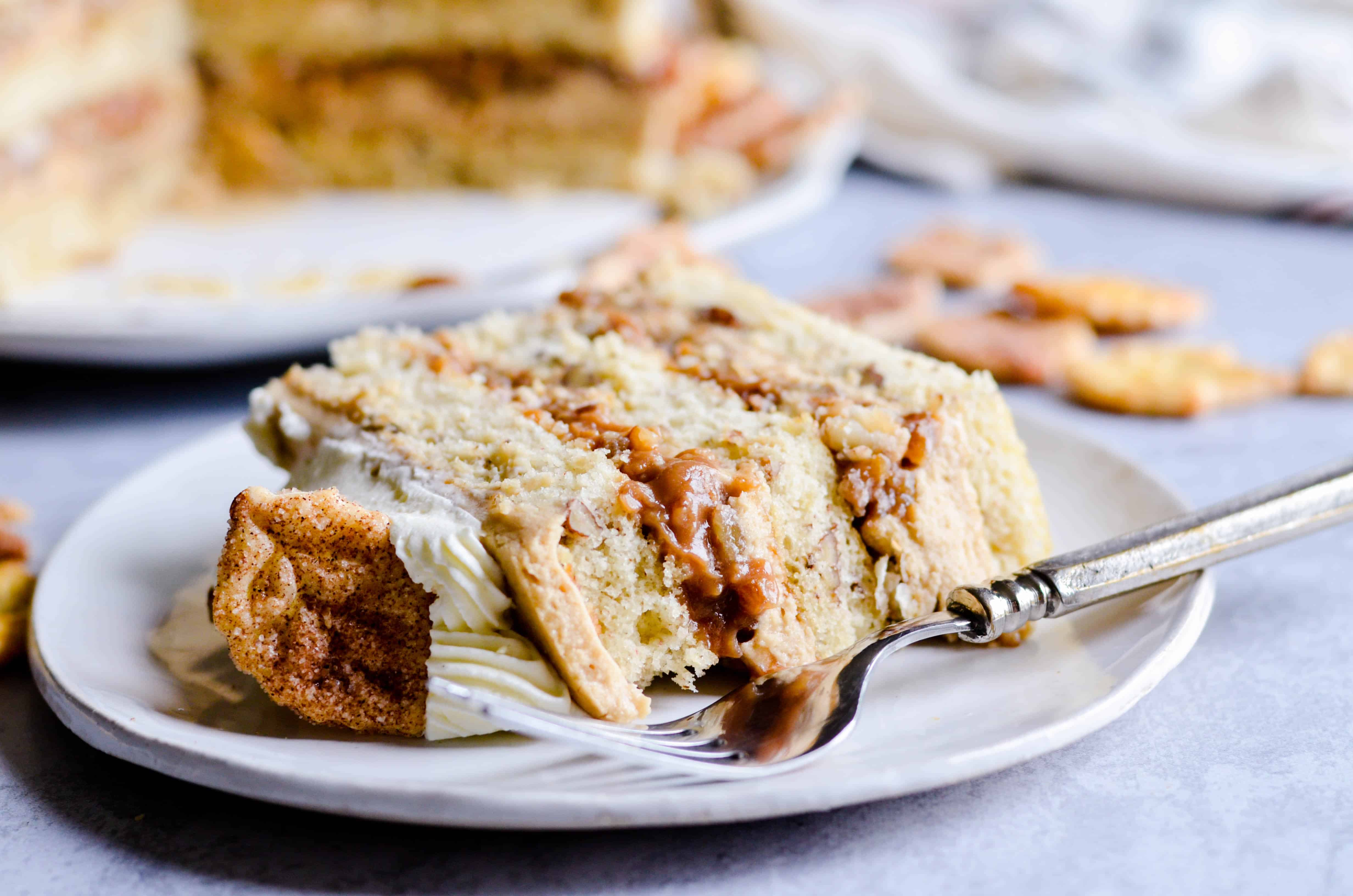 Light and airy pecan pie cake layered with caramel buttercream and a no-bake pecan pie filling. This cake is everything you want on Thanksgiving day!