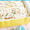 If you love licking the bowl, you'll be in heaven with this recipe for cake batter cinnamon rolls that are fluffy, soft, full of cinnamon, and topped with a dreamy cake batter cream cheese icing.