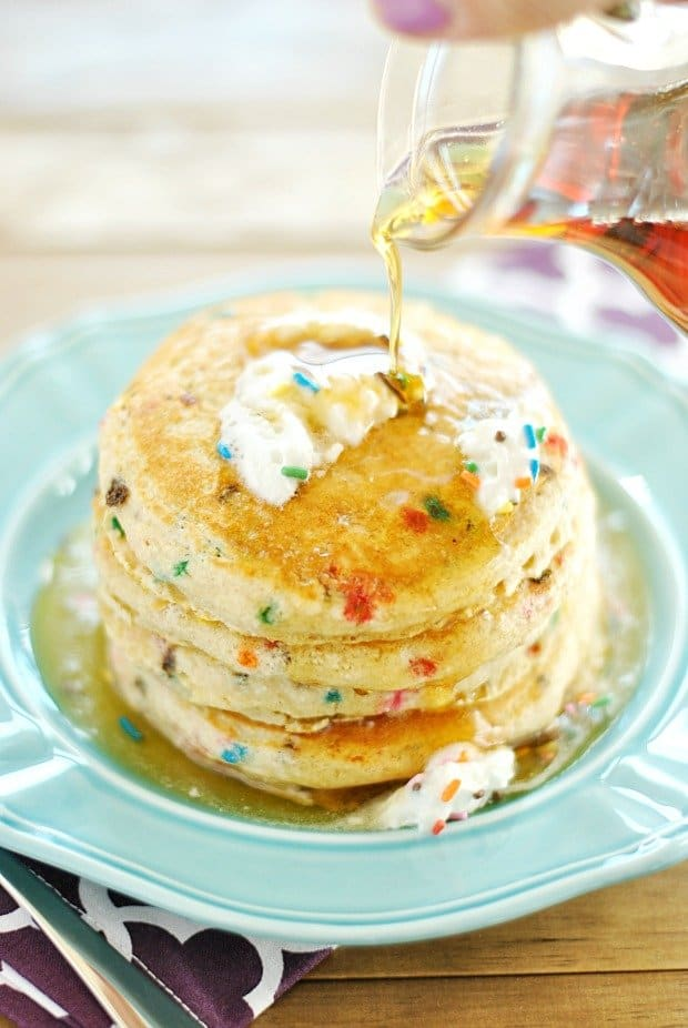 Skinny Funfetti Buttermilk Pancakes are fluffy, taste like cake, and are full of healthy oats that make for a great start to the day. Use a gluten-free baking powder to make these pancakes 100% delicious and GLUTEN-FREE!