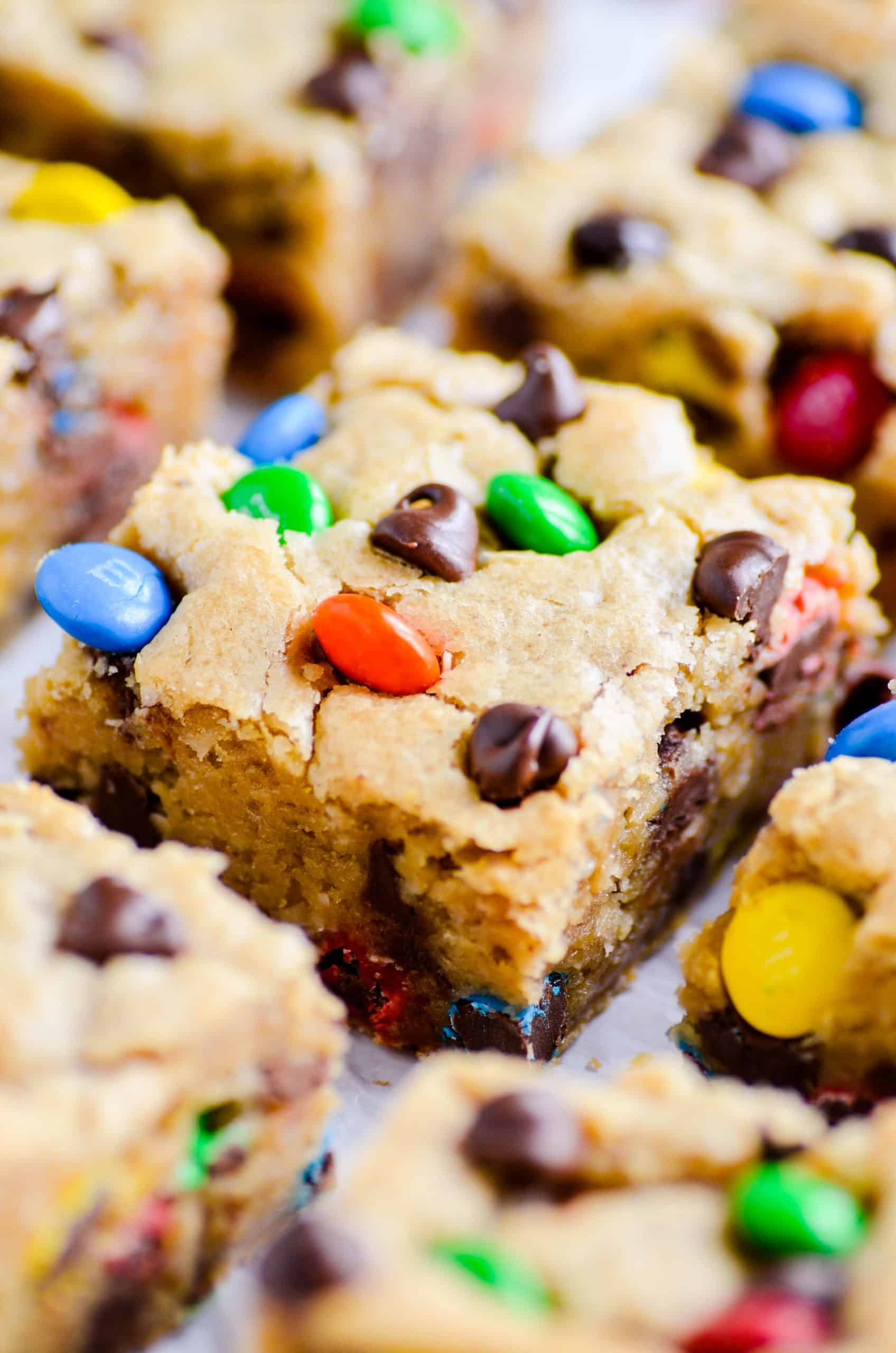 These Monster Cookie Blondies are my favorite cookie in bar form. Supremely fudgy and bursting with peanut butter flavor, these blondies will be a hit with everyone!