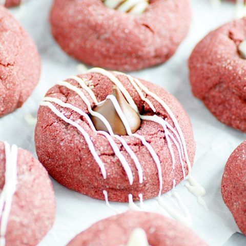 Soft and fluffy Red Velvet cookies topped with Hershey's Hugs and Kisses.