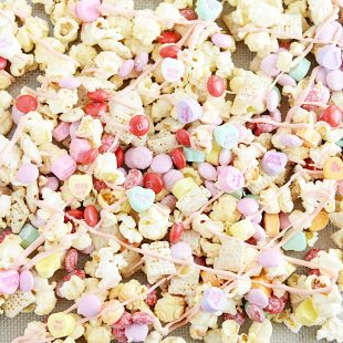 Kettle corn, chex cereal, and your favorite Valentine's Day candy coated in white chocolate.