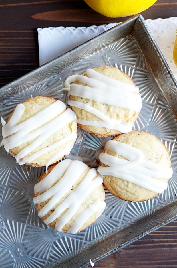 My twist on the traditional lemon poppyseed muffin! Sweet, soft muffins with subtle notes of vanilla and almond topped with a creamy lemon glaze.