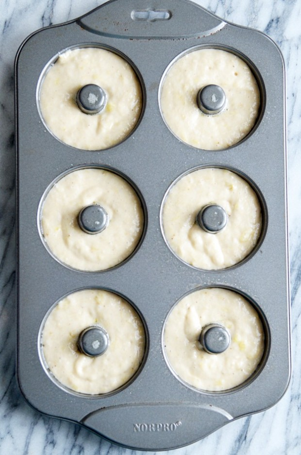These moist banana bread donuts are baked, not fried! So simple to make and so delicious with a rich chocolate glaze on top.