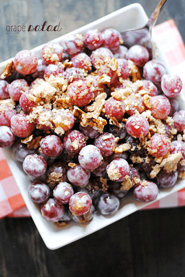 To me, this grape salad says WELCOME SUMMER! Sweet juicy grapes, sweet cream cheese-y goodness, and crunchy pecans and brown sugar are a dream come true. So yum and so easy.