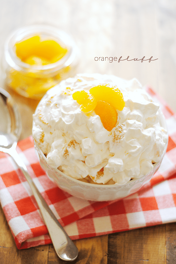 Once summer rolls around, my family makes a big batch of this orange fluff at least once a week. We just can't get enough of the sweet oranges and puffy marshmallows all wrapped up in sweet cream and yogurt