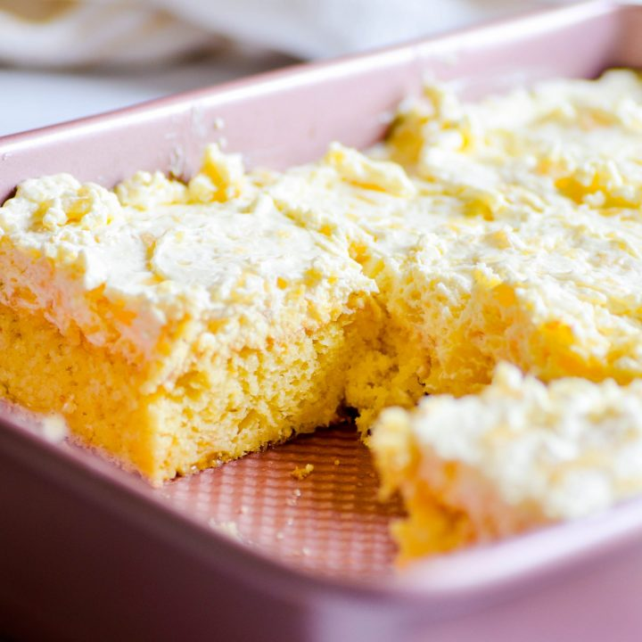 Moist, fluffy, buttery yellow cake filled with juicy mandarin oranges topped with a cool, creamy pineapple and whipped cream frosting-- Grandma's Pig Cake is the ultimate summer time dessert!