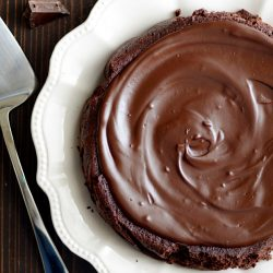 This deep, dark chocolate cake is incredibly rich and moist. And it is SO easy to make. You'll impress your friends and family with this recipe!