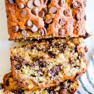 My mom's banana bread is full of chocolate chips and is SUPER soft and moist thanks to 4 whole bananasand a little bit of oil. It's the best!