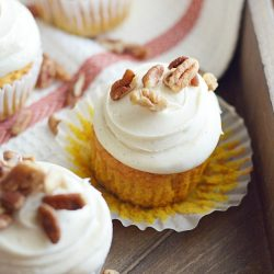 Soft and moist pumpkin cupcakes topped with my favorite cream cheese frosting and pecans.