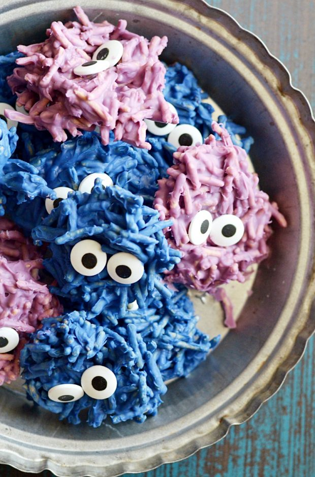 These spooky haystacks are all dressed up for Halloween! 2 simple ingredients and candy eyeballs are all you'll need to make these easy Hair Monster Cookies that kids of all ages will love.