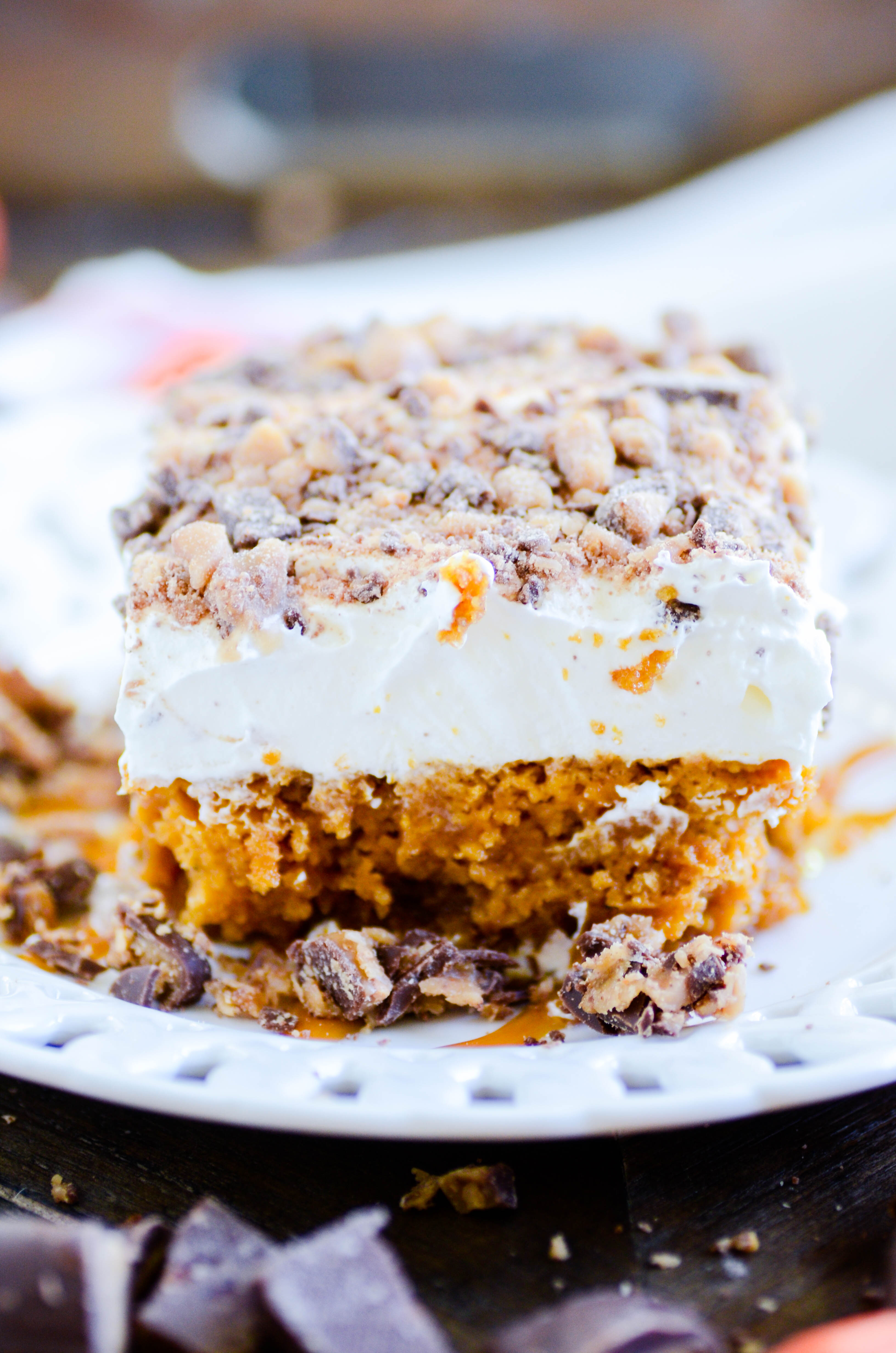 This Pumpkin Caramel Poke Cake is your new favorite Fall staple!