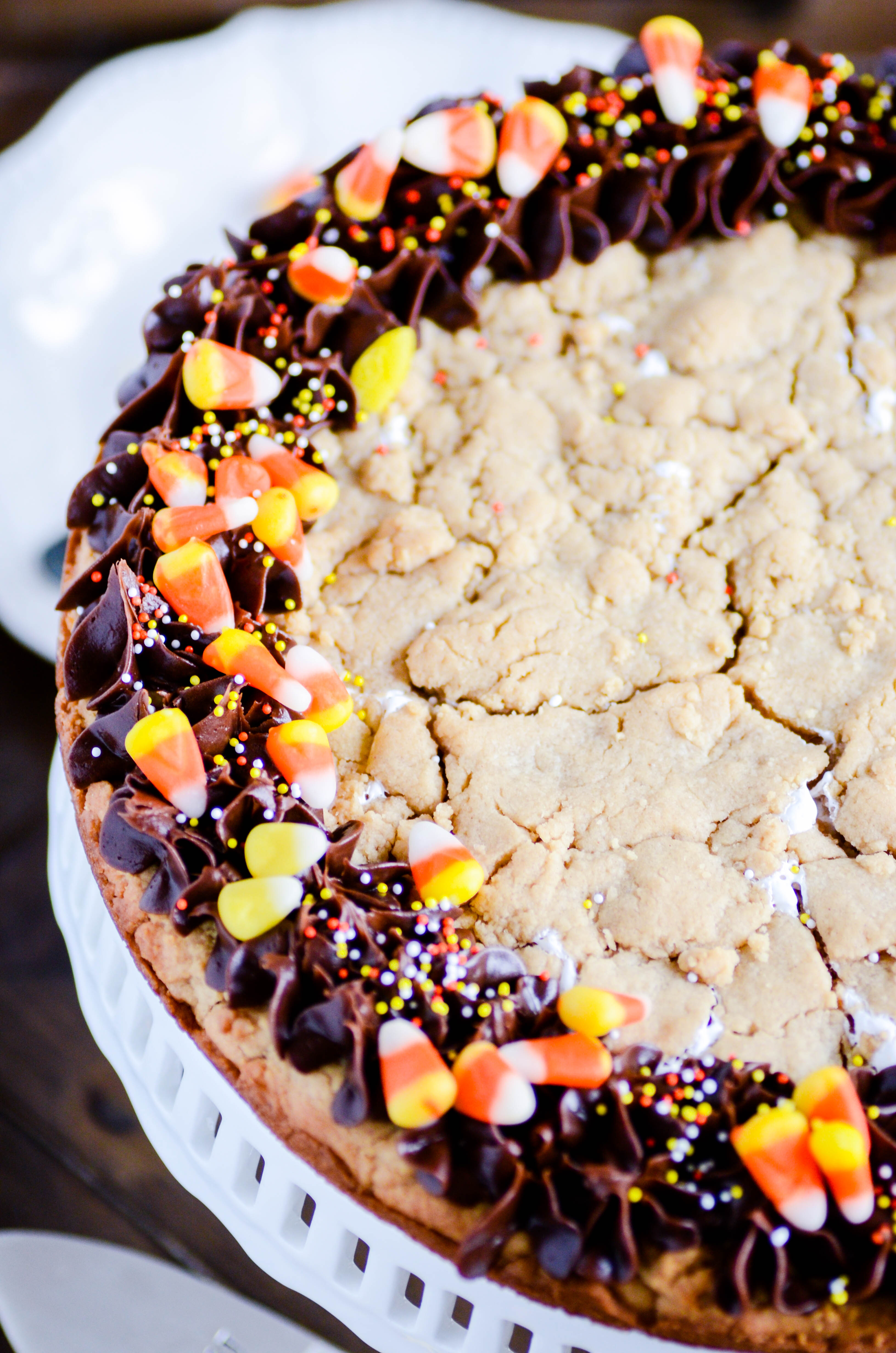 A peanut butter cookie the size of a cake filled with marshmallow cream! Topped with chocolate frosting and candy corn. Slice and serve!