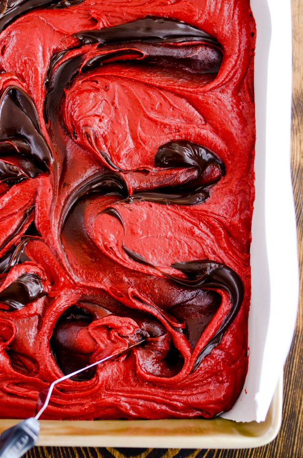 These hot fudge swirled red velvet brownies (made from scratch!) are super fudgy and indulgent. The perfect red velvet recipe for your Valentine's Day treat!
