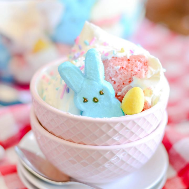 A sweet and easy Easter trifle made with pink velvet cake, cheesecake mousse, and Peeps marshmallows.