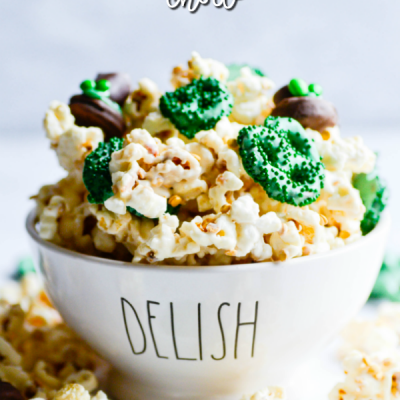 """Leprechaun Chow is a fun and festive St. Patrick's day treat! Made with white chocolate coated kettle corn and rice cereal with candy coated pretzel """"clovers""""."""