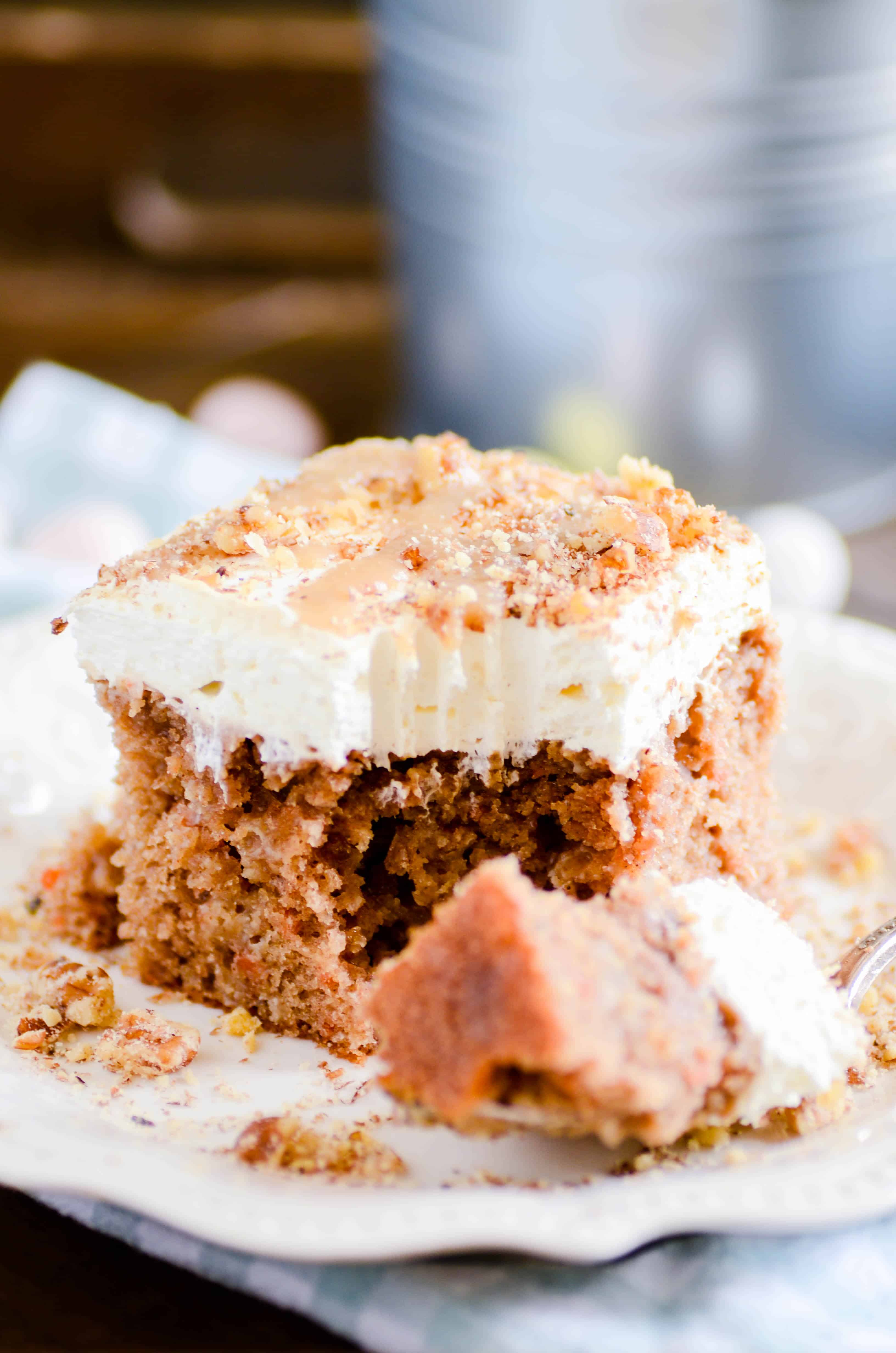 Carrot cake soaked in a homemade caramel sauce topped with a cream cheese whipped topping. This is an Easter show stopper!
