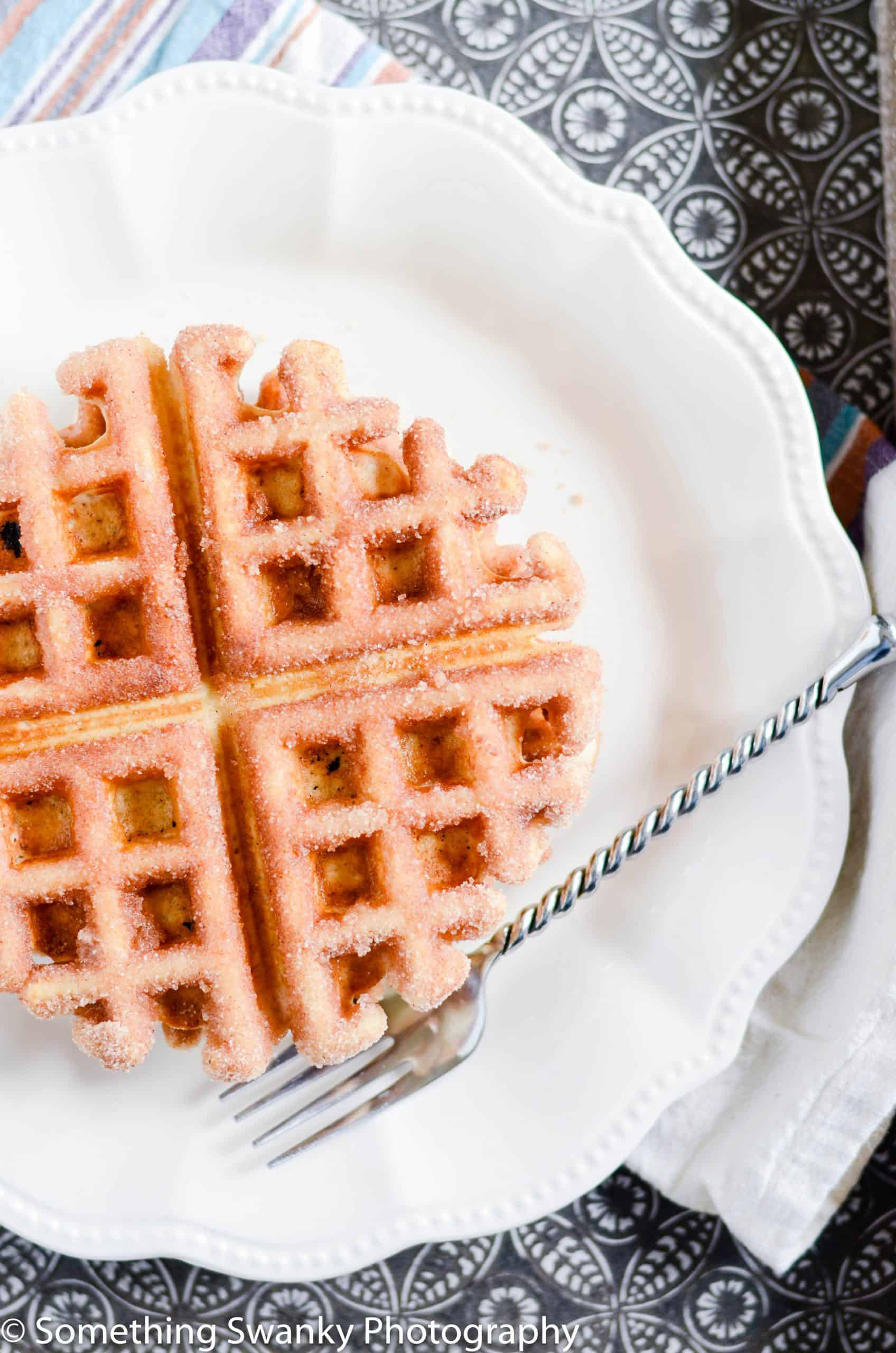 These waffles are so easy to make and absolutely melt-in-your-mouth incredible. My favorite Belgian Waffles dipped in butter and coated in cinnamon sugar.
