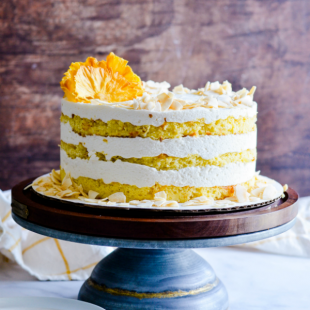 Extra moist pineapple coconut cake with a sweet coconut buttercream and a toasted coconut topping.