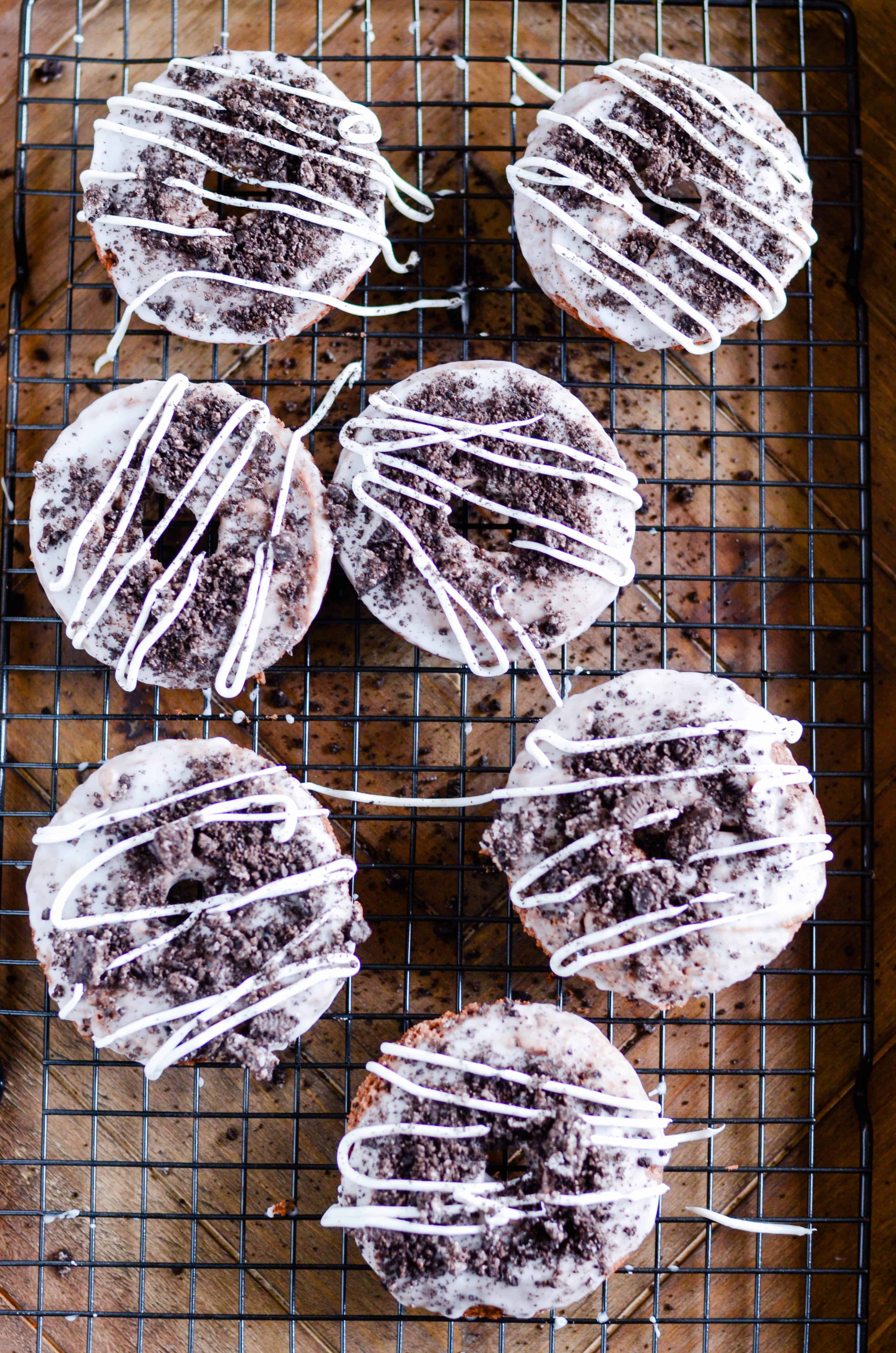 Moist chocolate donuts that are baked instead of fried, topped with a sweet glaze and Oreo crumbles.