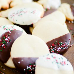 This easy shortbread has become one of my favorite Christmas cookies! It's easy to make and it tastes SO GOOD. Dip it in chocolate and add sprinkles to make any holiday plate prettier :)