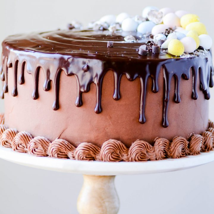 A mini cadbury egg cheesecake in between two layers of my favorite chocolate cake. Frosted with milk chocolate buttercream and topped with chocolate ganache!