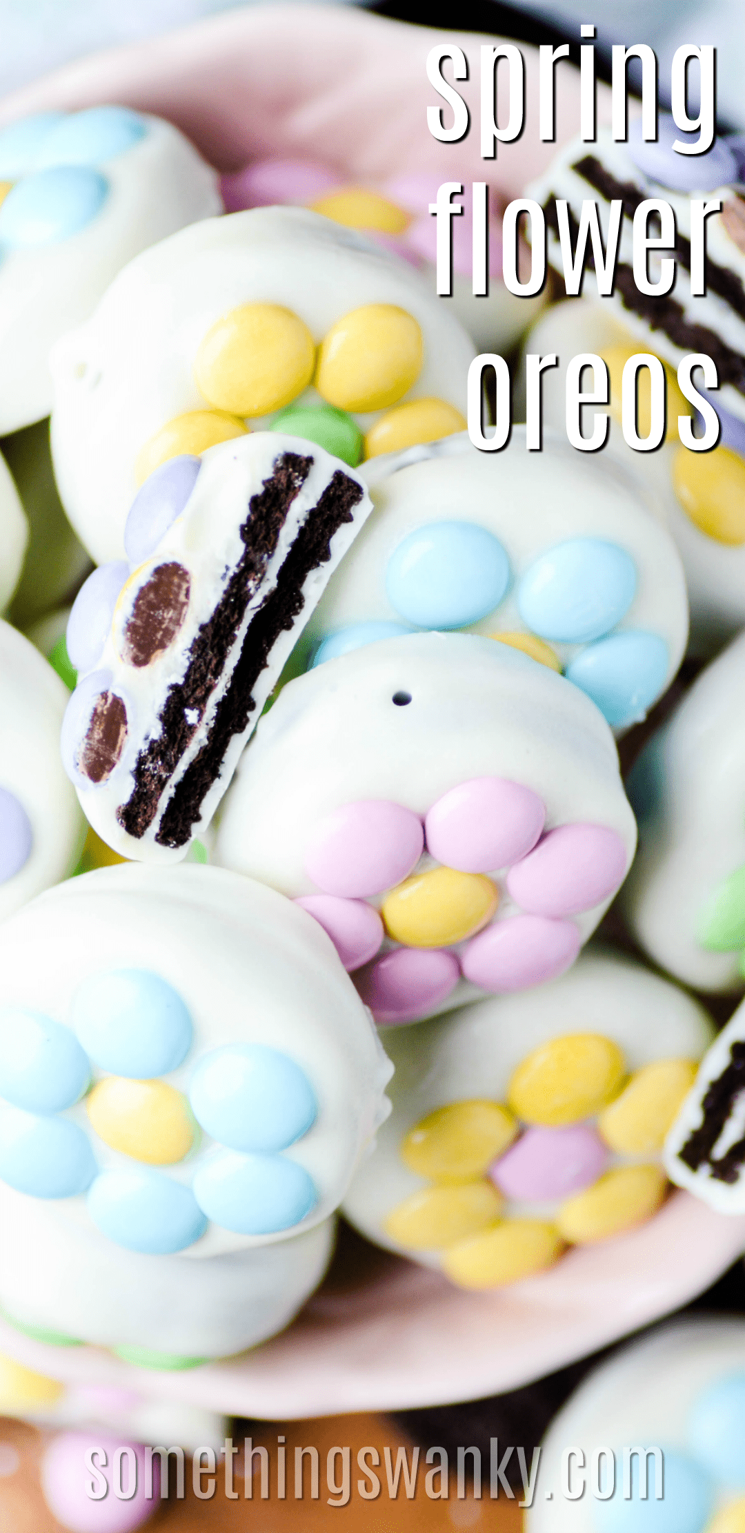 These white chocolate covered Oreos are decorated with spring flowers made out of M&MS. Easy to make, so cute, and delicious too!