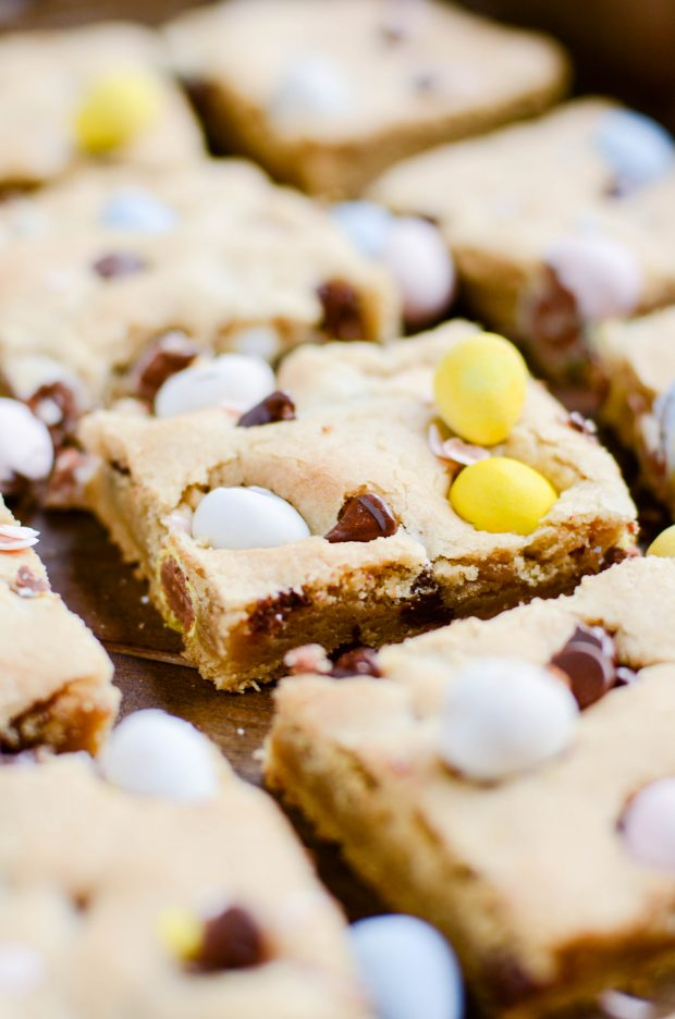 You don't even need a mixer to whip up a batch of these soft and chewy chocolate chip cookie bars full of miniature Cadbury Eggs. The perfect Spring-time cookie!