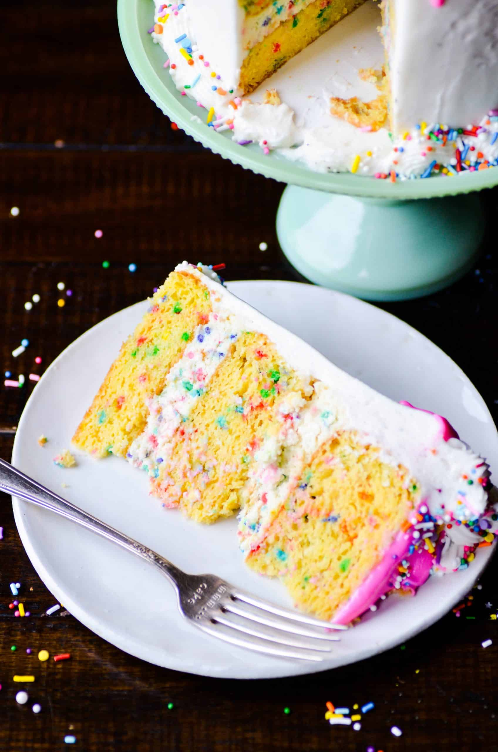Layers of funfetti cheesecake sandwiched in between layers of actual funfetti cake. Frosted in my favorite whipped vanilla buttercream topped with lots and lots of sprinkles!