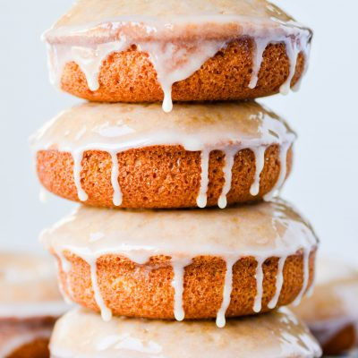 These Baked Whole Grain Donuts have a rich, nutty flavor with a hearty texture that stays soft and delicious. Add a simple maple glaze to take these to another level!