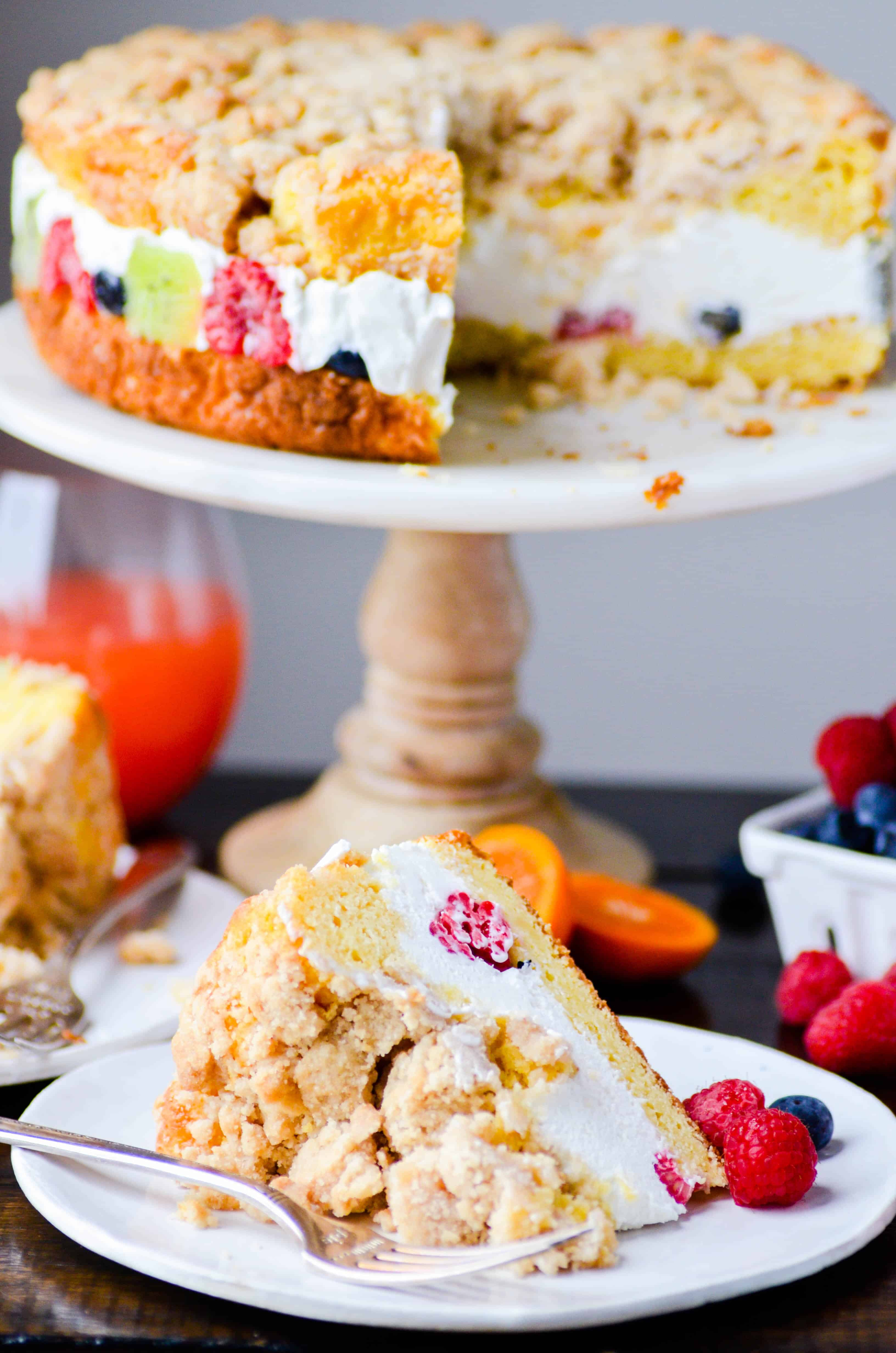 This gorgeous coffee cake is soft and moist, easy-to-make, and has a delicious layer of cheesecake and fruit in the middle!