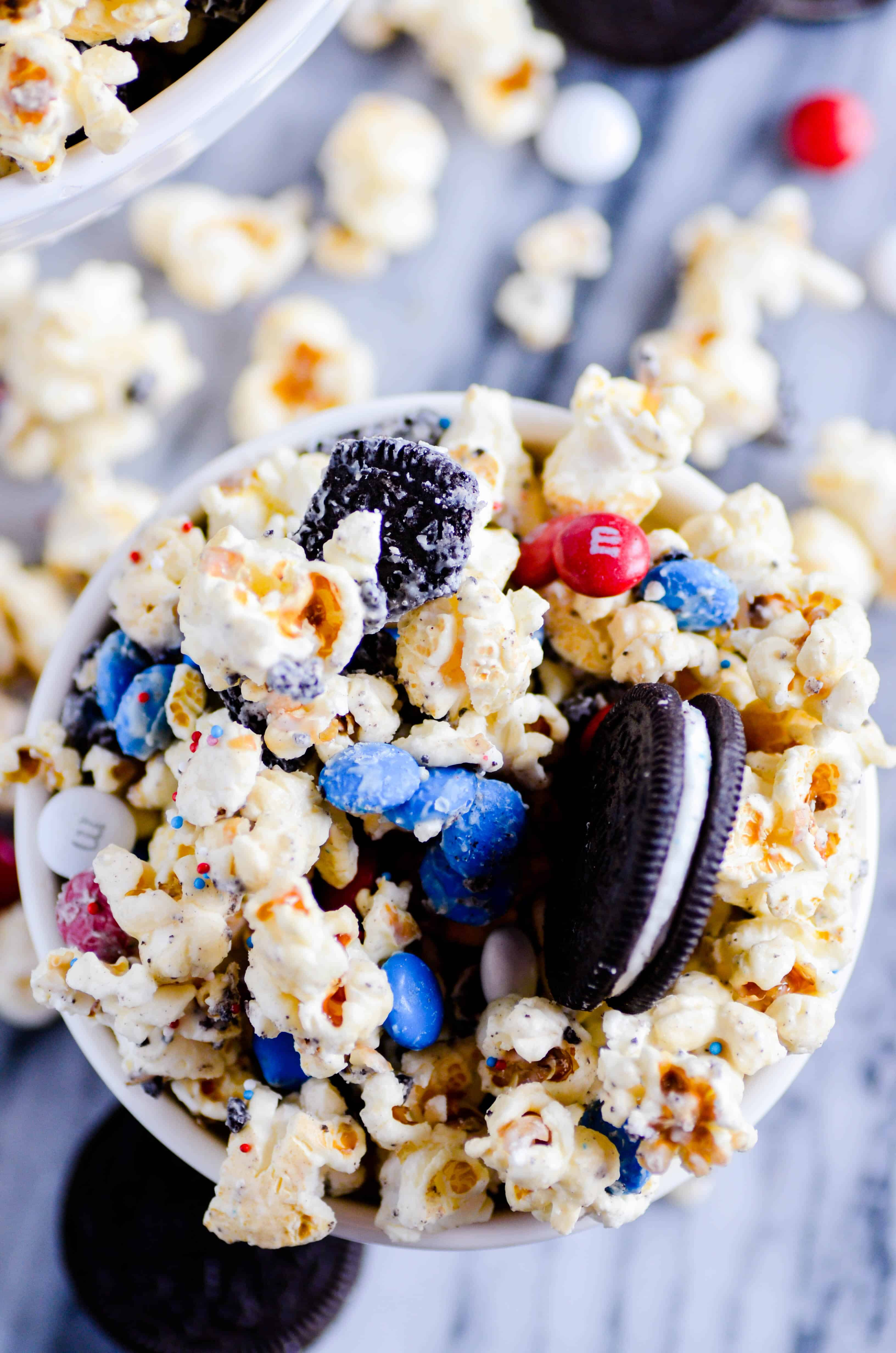 White chocolate coated kettle corn, M&MS, and Firecracker Oreos come together in just a few minutes to make this Firecracker Popcorn Chow.