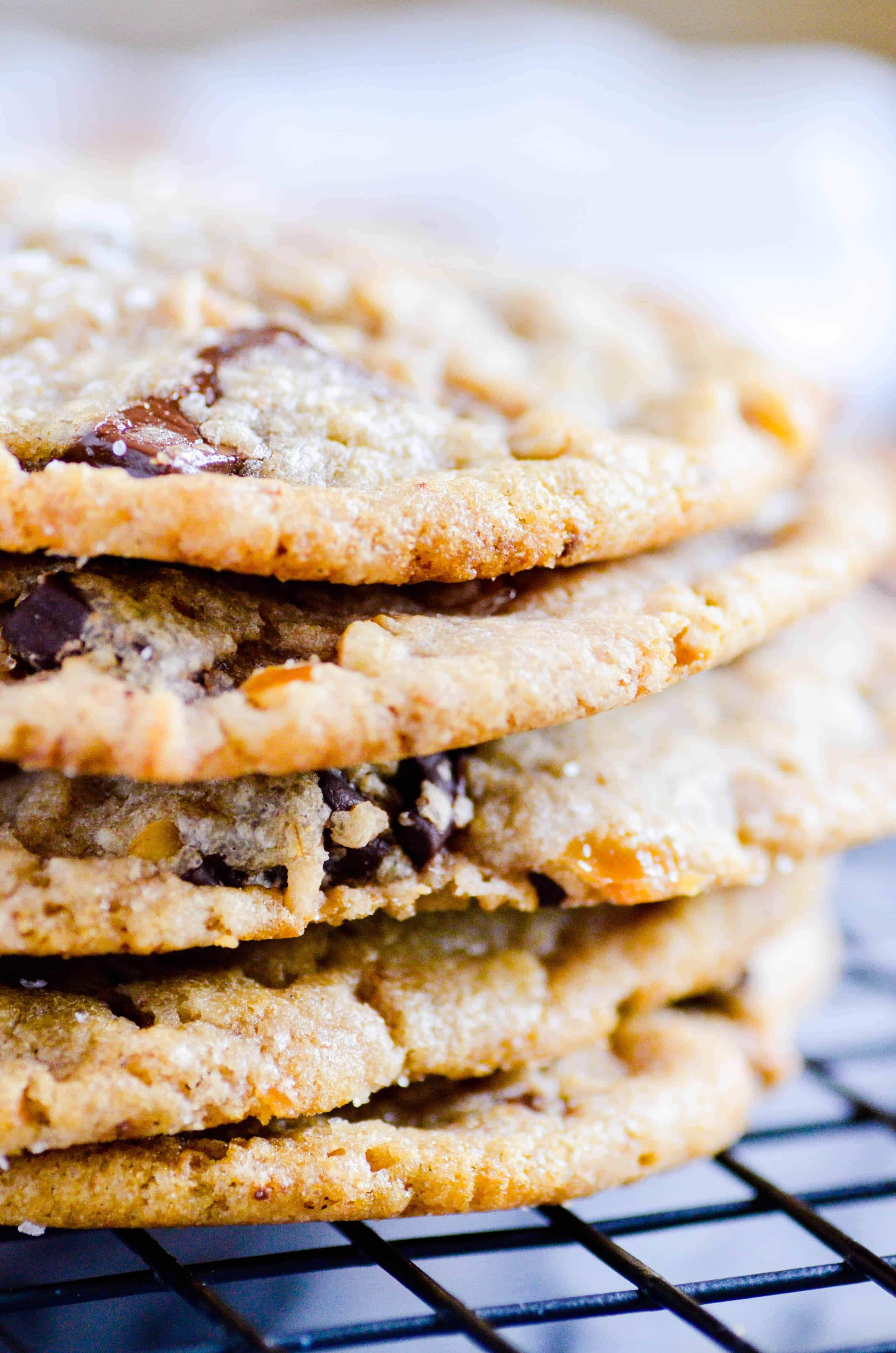 A perfect cookie filled with caramel, chocolate chunks, pretzels, and a sprinkle of flaky sea salt on top-- everything but the kitchen sink!