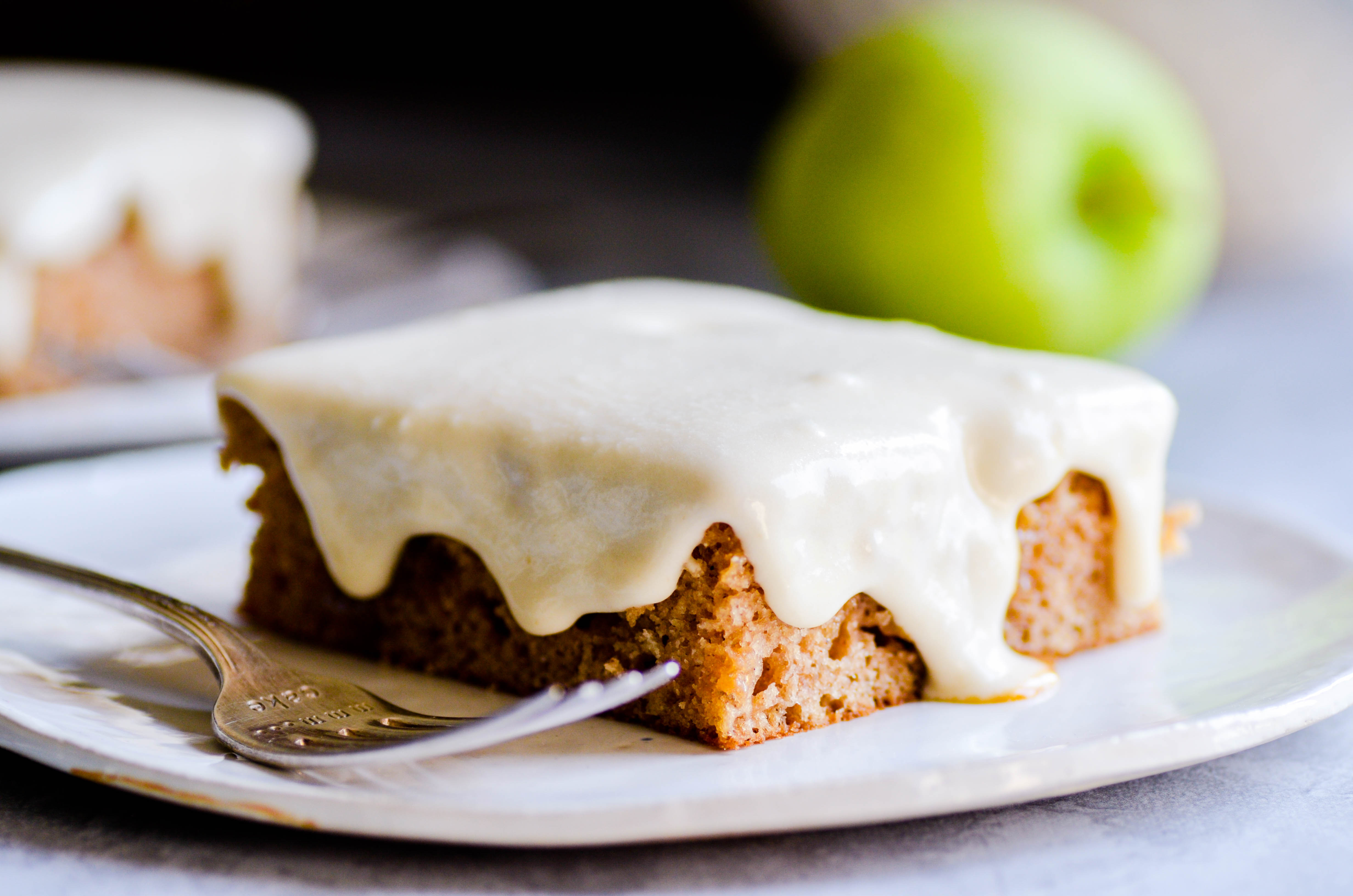 Delicious apple spice sheet cake soaked in caramel sauce and topped with caramel icing.