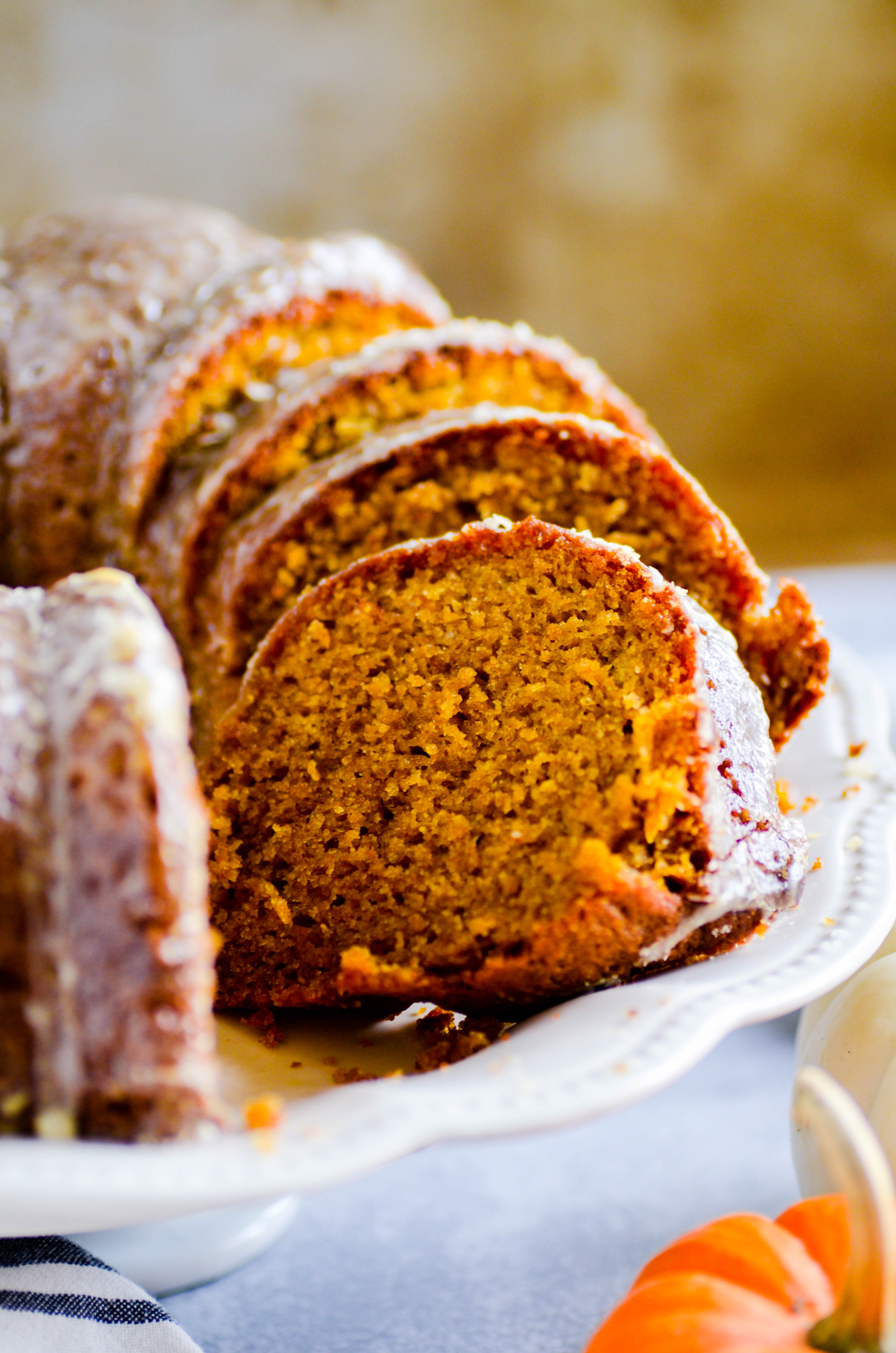 This Whole Wheat Pumpkin Bundt Cake with Maple Glaze is your new go-to Fall recipe for EVERYTHING.