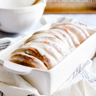 This Cranberry Walnut Pull Apart Bread with Maple Cinnamon Glaze will melt in your mouth! Perfect for a special holiday breakfast.