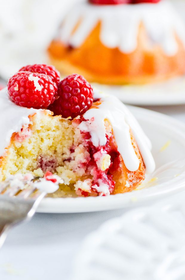These mini bundt cakes are bursting with lemon flavor, soaked in a sweet lemon syrup, and filled with juicy raspberries.