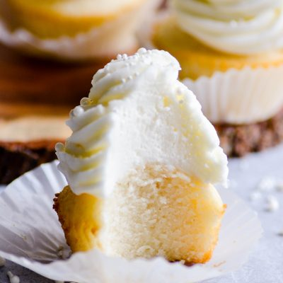 These wedding cake cupcakes are so good, you won't want to save them for weddings only. Make these moist, fluffy cupcakes with whipped buttercream any time!