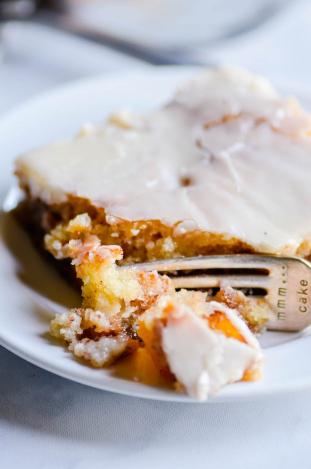 This peach cinnamon cake is a cross between peach cobbler and cinnamon rolls, and it's absolutely amazing!