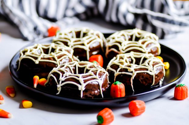 Double chocolate donuts with easy spider webs on top for Halloween!