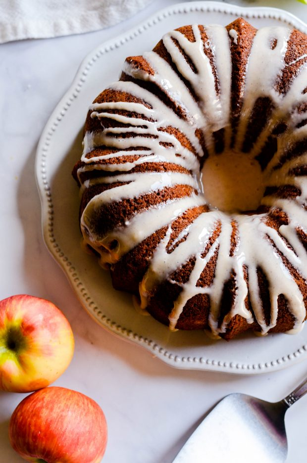 This Apple Spice Cake with Maple Cinnamon Glaze is your new go-to Fall recipe for EVERYTHING. Supremely moist and flavorful!